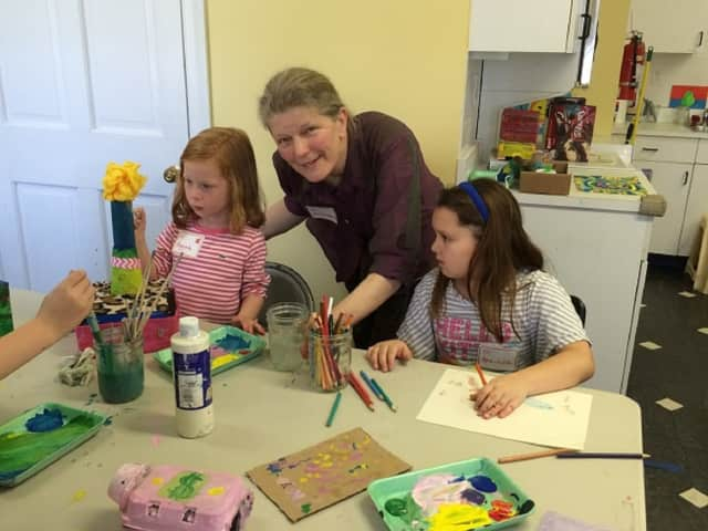 Augusta Wartels, YW art teacher Rowanda Shepard and Ana Julia Carnavale at a recent arts and crafts workshop at the YW.