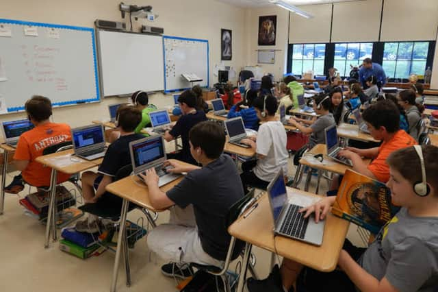 Tuckahoe Middle School students are shown using Chromebooks in the classroom.