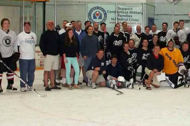 Some of the 200 players in a marathon hockey game in Ridgefield this weekend get ready to skate. The game will benefit Play For Purpose.