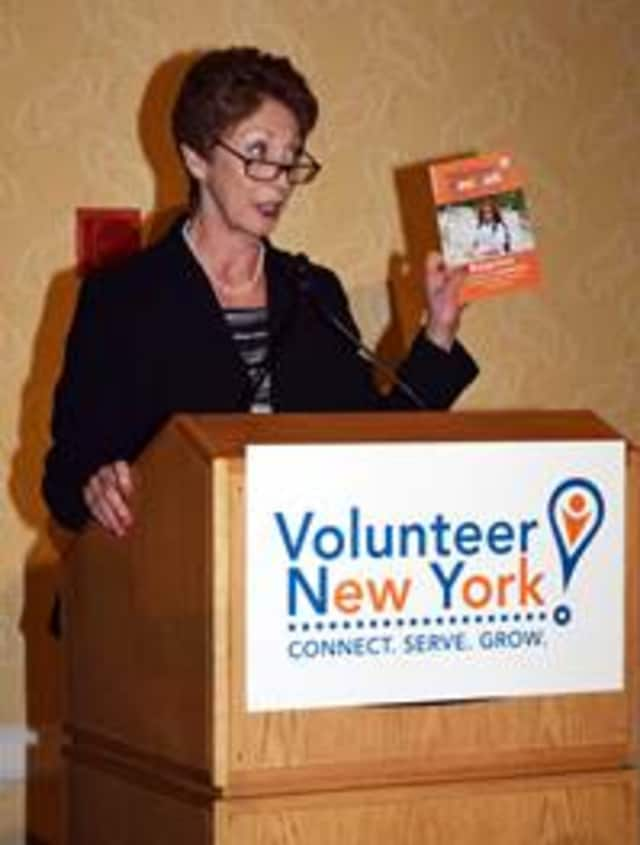 Presenter Paula Mandell showcasing the Volunteer New York! Orange Book, a volunteerism guidebook, at the recent Volunteer Spirit Awards in Tarrytown.
