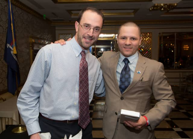 Adam Rosen, Berkeley College director of counseling, Student Development and Campus Life with student Jose Pagan, a veteran of the U.S. Army, who told his heartfelt story about facing homelessness after his military service.
