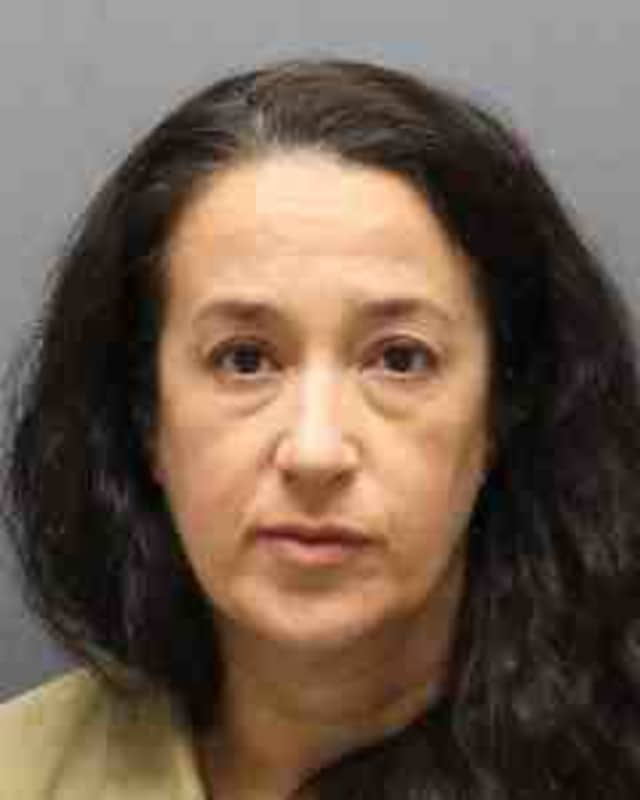 A Yonkers woman was charged with shooting her husband in the head while he slept.
