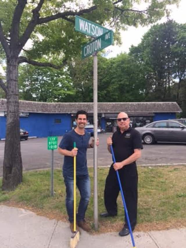 Mike Risko and John Giralomo of the Ossining Chamber of Commerce, sweeping Croton Avenue in a team effort to kick off the Uptown initiative.