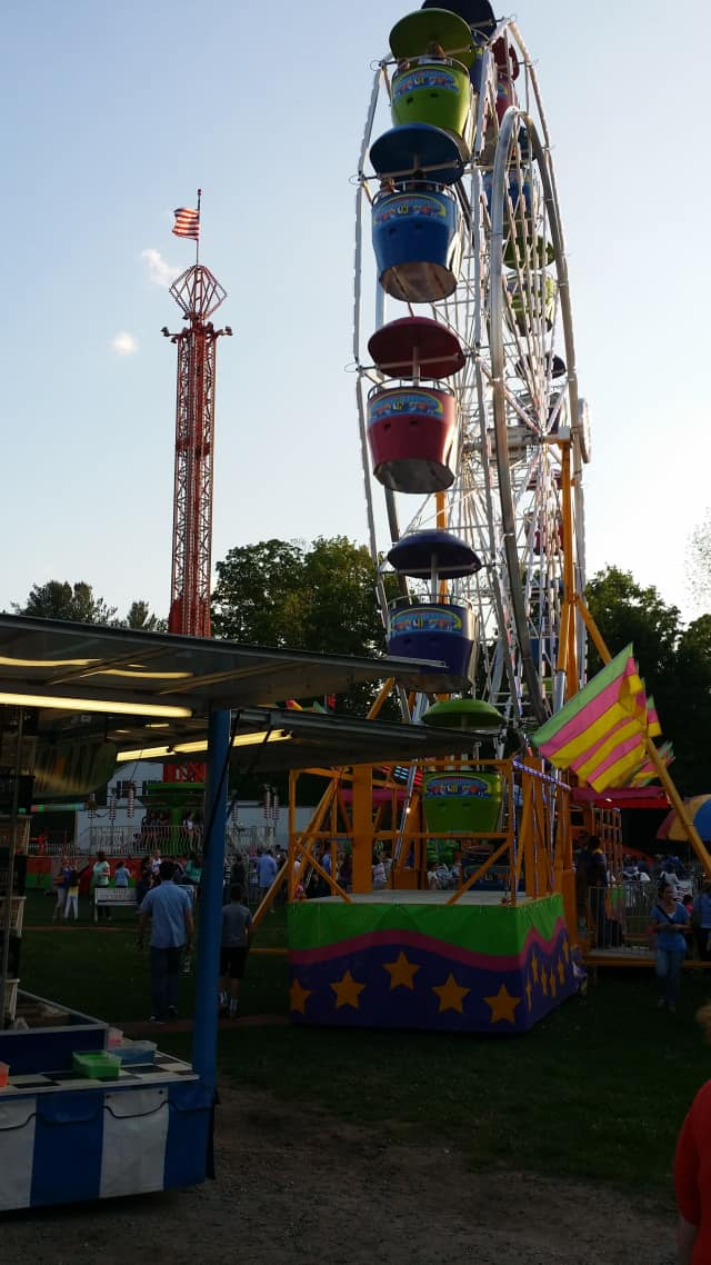 A Ferris wheel and tower at the St. Patrick's School carnival in Bedford Village.