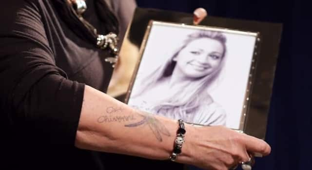 Deborah Carlin Polhill of Cortlandt Manor holds a photo of her late daughter, Cait Chivonne Polhill, who died in 2011 at age 28.