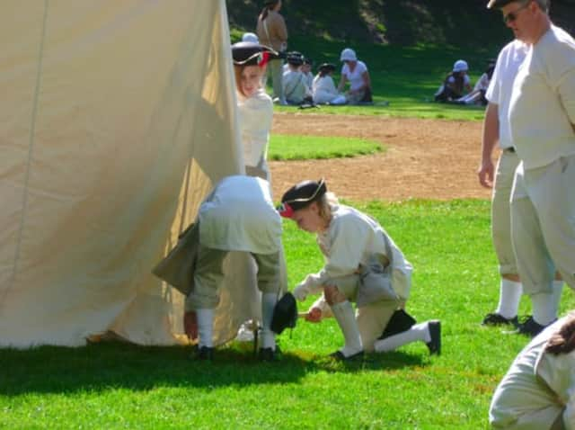 Students from Pleasantville's Bedford Road School pitch a tent during Revolutionary War re-enactment.