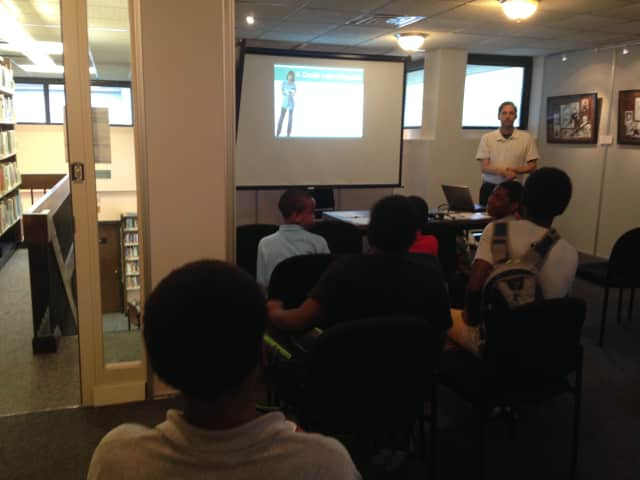 Chris Dlugozima, a certified consumer credit educator, recently held a money management workshop for teens at the Field Library in Peekskill.