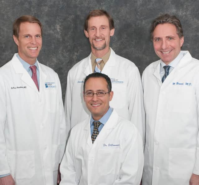 Four physicians at Danbury Orthopedic (back, left to right) Ross Henshaw, MD, John Lunt, MD, Michael Brand, MD, and Joseph DiGiovanni, MD (front) have been named Top Doctors by Connecticut Magazine.