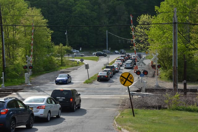 The grade railroad crossing in Chappaqua, pictured with afternoon rush-hour traffic on Friday, May 15.
