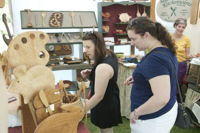 Festival-goers check out a kitchenware display at a previous Outdoor Crafts Festival at the Bruce Museum in Greenwich.