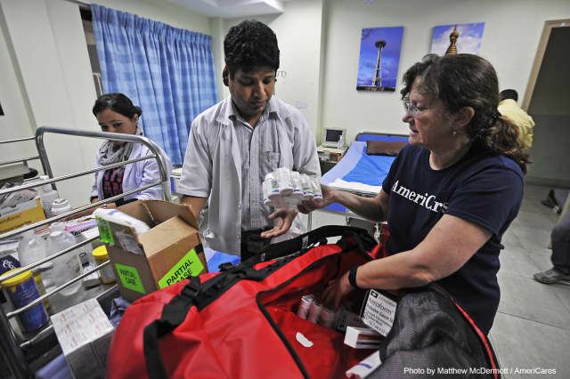 Dr. E. Anne Peterson of AmeriCares delivers medicine to the Nepal Cleft & Burn Center on April 29.