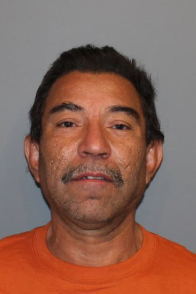 William Gaviria, seen here after his May 14 arrest, was charged with kicking officers during an outburst at his home Tuesday.