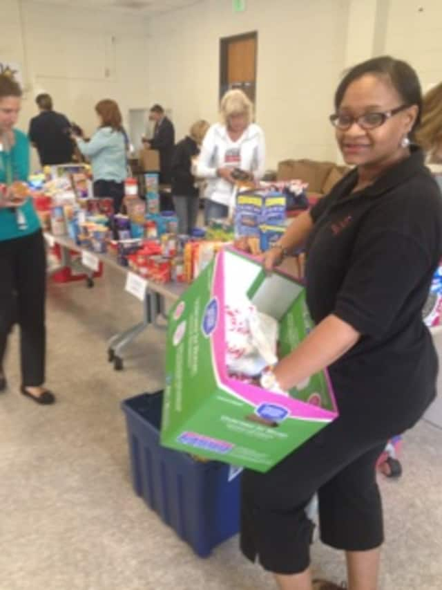 Chereese Jervis-Hill, president, Events To Remember, helps pare care packages.