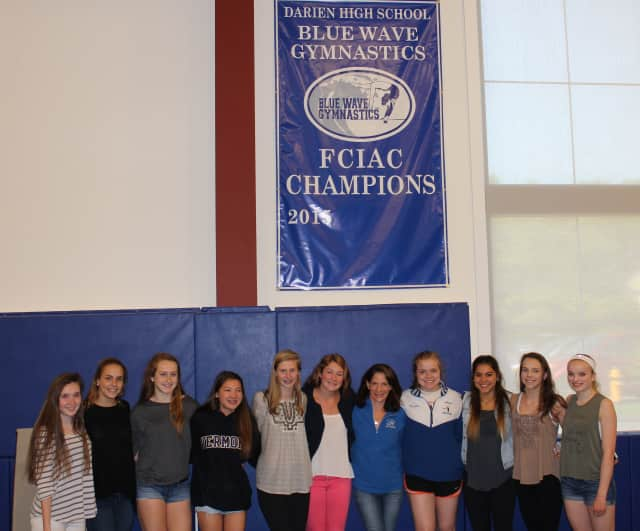 Members of the Darien Blue Wave gymnastics team, which recently won the  the Fairfield County Interscholastic Athletic Conference championship meet.