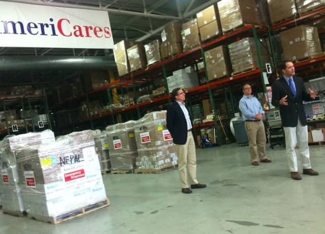 U.S. Rep. Jim Himes, D-4th District, speaks at an event Friday morning at AmeriCares, where he thanked the organization for its response to the Nepal earthquake. Al left is Americares President Michael J. Nyenhuis and Garrett Ingoglia, center.