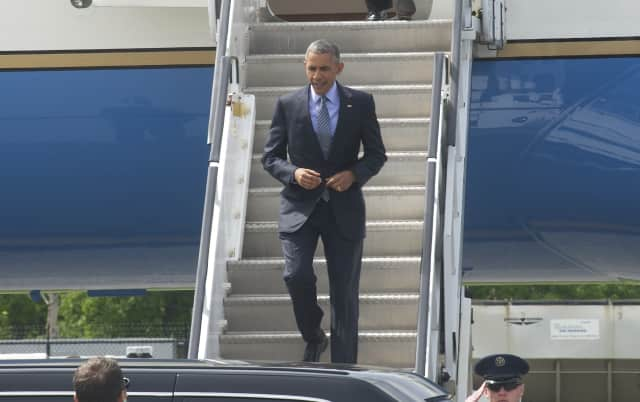 President Barack Obama steps off Air Force One at Westchester County Airport on his way to a fundraiser in Stamford.