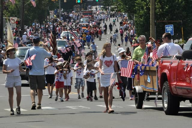 Norwalk's 2012 Memorial Day Parade makes its way toward the I-95 overpass on East Avenue.