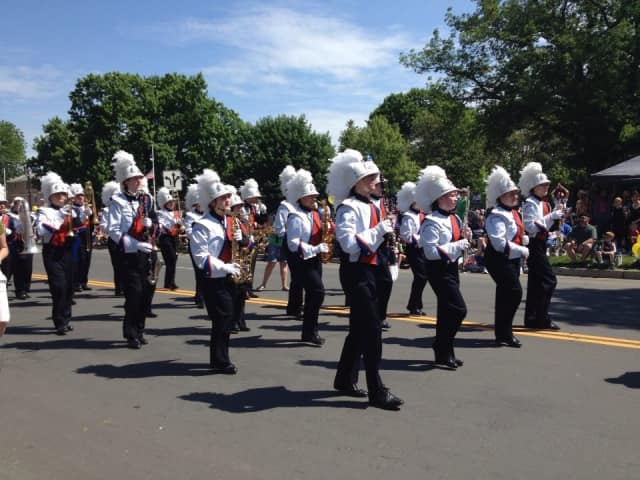 The Danbury High School Marching Band takes part in a Memorial Day parade.