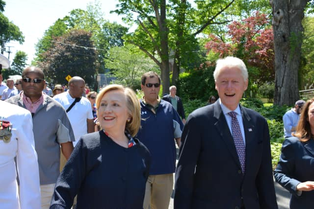 Bill and Hillary Clinton march earlier this year in New Castle's Memorial Day parade in downtown Chappaqua.