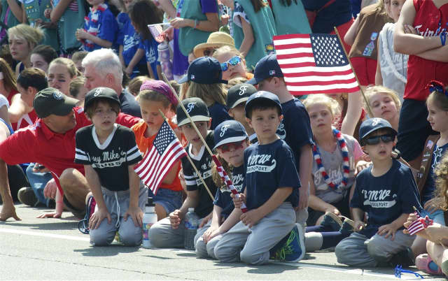 A group of Little Leaguers watches the Memorial Day parade in Fairfield in a past year.