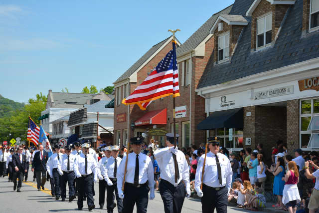 Local firefighters march in New Castle's Memorial Day parade, which was held on Monday in downtown Chappaqua.