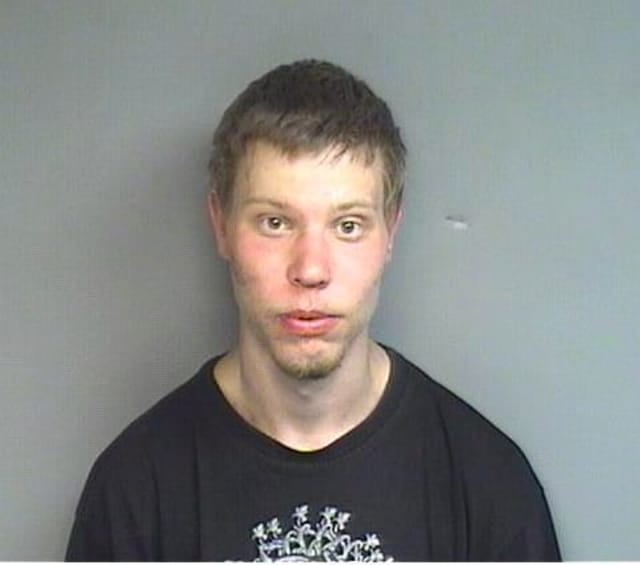 Matthew J. Baran, 24, of Charleston, N.H., was charged with weapons offenses after carrying a handgun while walking intoxicated on a city street Monday, police said.