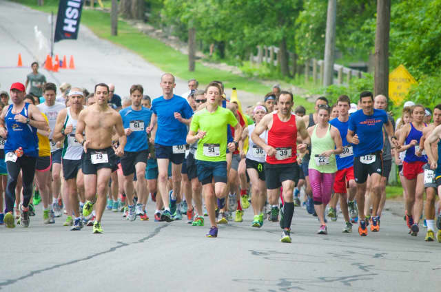 Runners take off on a previous South Salem Memorial Day 10K.
