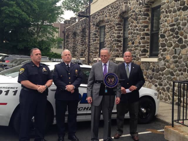 """Eastchester Police Lt. Jeff Hunter, Chief Tim Bonci and Town Supervisor Anthony Colavita standing with New York Sen. Chuck Schumer as he introduced legislation for """"swatting"""" incidents."""