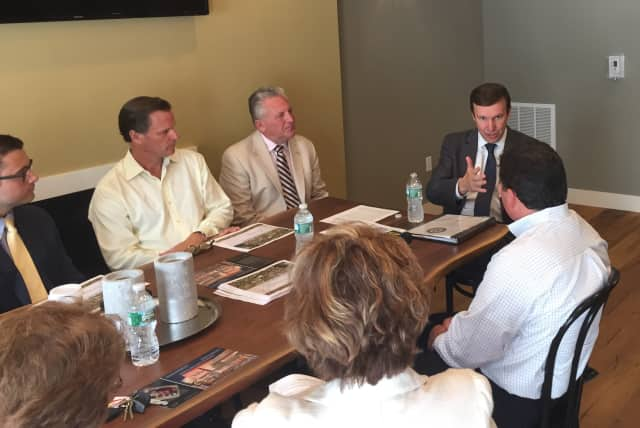 Sen. Chris Murphy meets with developers of the Waypointe and 95/7 mall projects, as well as Norwalk officials to discuss a new transportation system to connect the different ends of the city.