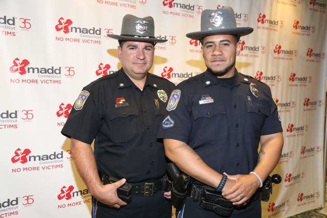 Western Connecticut State University police officers Trevor Burke, left, of Waterbury, and Luis DosSantos, of Wolcott, recently were honored for their efforts to prevent drunken driving in Danbury.