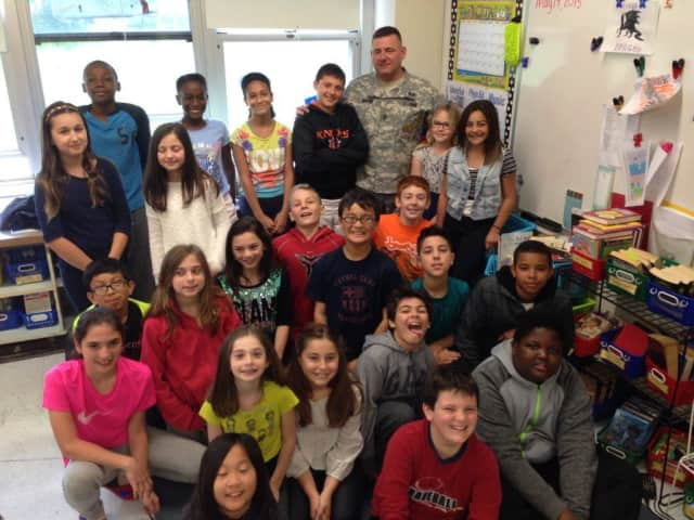 First Sgt. William Howard, who has served in the U.S. Army for 24 years, recently visited fifth-graders at Eastchester's Anne Hutchinson School.
