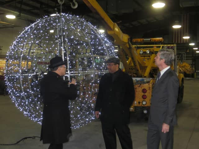 """Former White Plains Public Works Commissioner Joseph """"Bud"""" Nicoletti, left, and Mayor Thomas Roach, right, inspect the ball that was dropped on New Year's Eve 2015. Nicoletti was fired by Roach and his Common Council on Tuesday."""