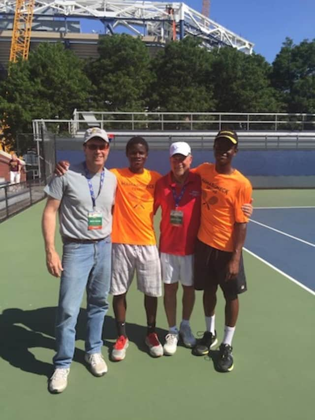 Courage and Hope Crawford, New York State tennis champions with their coaches on Saturday.