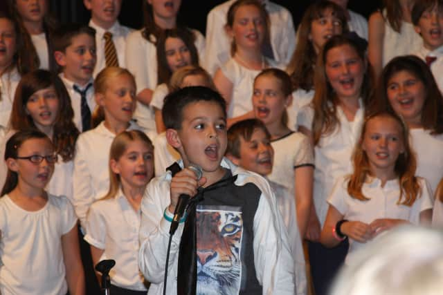 Soloist James Tomasello performs with his peers at Holmes Elementary School's spring concert.