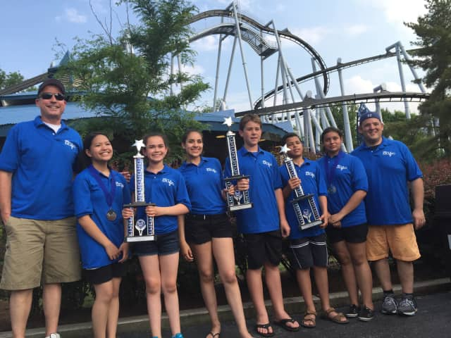 Lindsey Co, Port Chester Middle School Band President Isabel Sanchez, PCMS Chorus President Isabella Ramos, Chorus Vice President Kyle Baxter, Band Vice President Eli Taylor-Lemire and Isabella Rios, with trophies won in the competition.