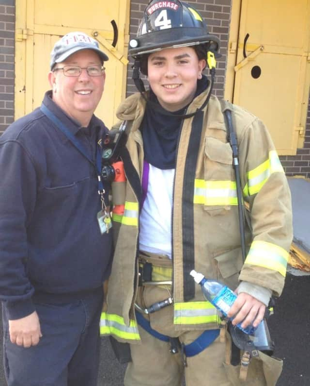 Charles Nielsen, Port Chester High School senior, right, with his instructor Richard Dempsey, captain of the Eastchester Fire Department.