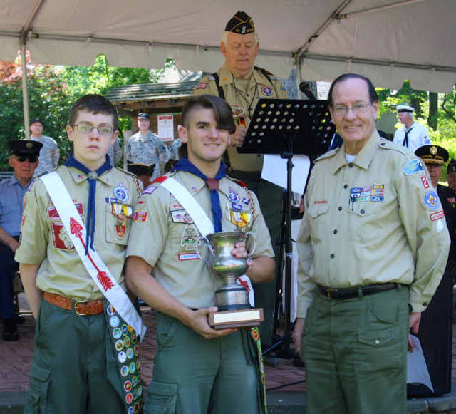 Pictured with the Harrington Cup for Advancement are Troop 2 Chairperson Edward Mann and Scouts Aidan Connolly, far left, and Eddie Gruber.