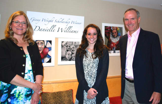 Amy Allen, Darien Arts Center executive director, left, Danielle Williams and Steven Wright at the 57th annual Darien Art Show & Sale reception, where Williams was awarded the 2015 Ginny Wright Scholarship.