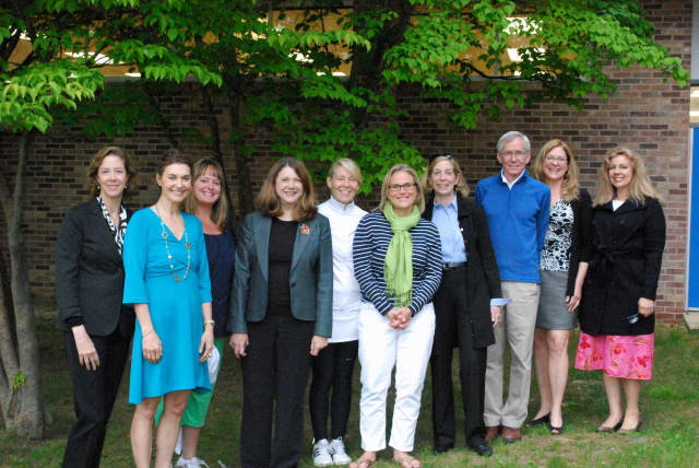 "Darien Arts Center board members at a meeting to confirm plans for the DAC spring fundraiser, ""A Midsummer Night's Celebration,"" taking place on June 20."