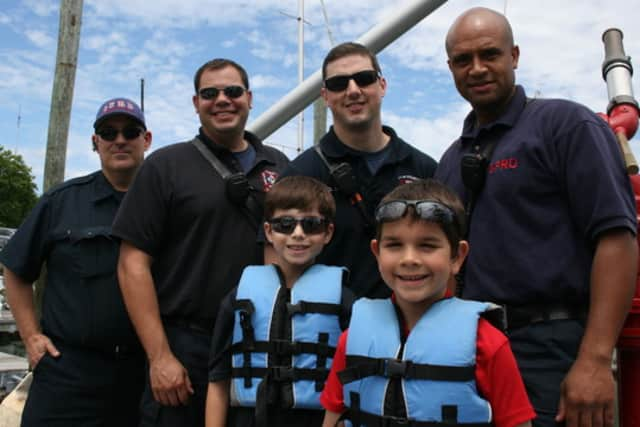 Two boys were among the fishermen in last year's Hooks For Heroes competition, which is sponsored by Halloween Yacht Club of Stamford.