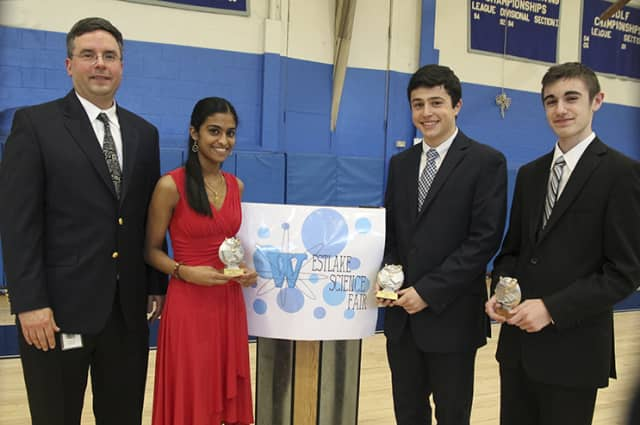 From left, Lawrence McIntyre, science research teacher and Westlake Science Fair organizer, with Westlake students and award winners Meenu Mundackal, Peter Psaltakis, and Ryan Stasolla.