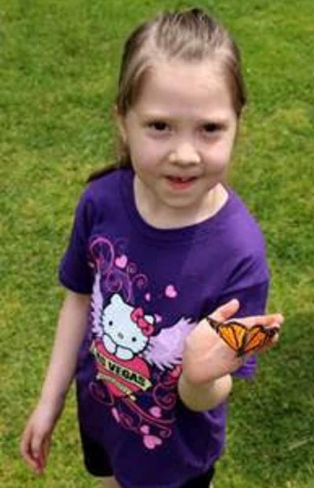 Butterflies delighted children by landing on their fingers at the Fifth Annual HPCW Memorial Butterfly Release in Rye recently.