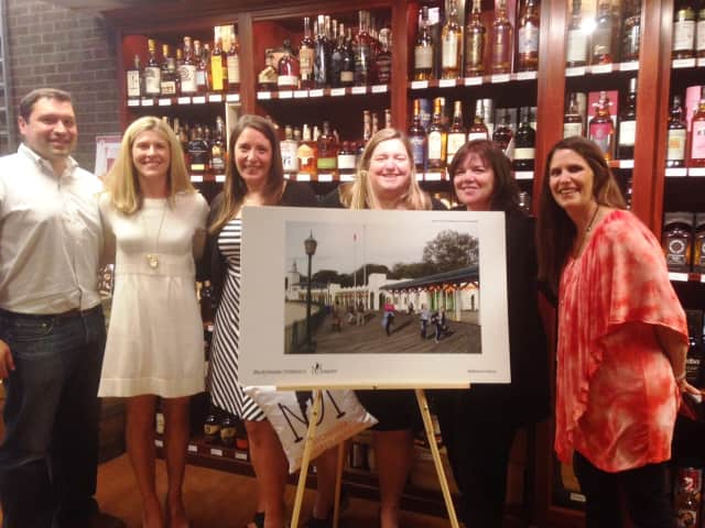 From left to right: Anthony D'Arpino, Carly D'Arpino, Francesca Vitti, Maggie O'Hara, Heather Waters and Carolyn Spencer at the Harrison Wine Vault's recent fundraising event.