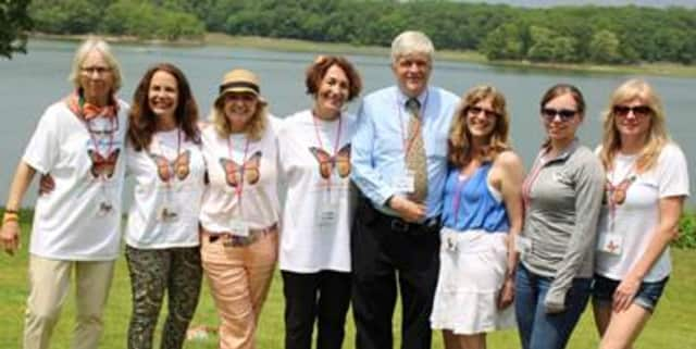 HPCW Bereavement Coordinator Bruce Page, MAT, MDiv, (Chappaqua, center) with HPCW staff at the Fifth Annual HPCW Memorial Butterfly Release.