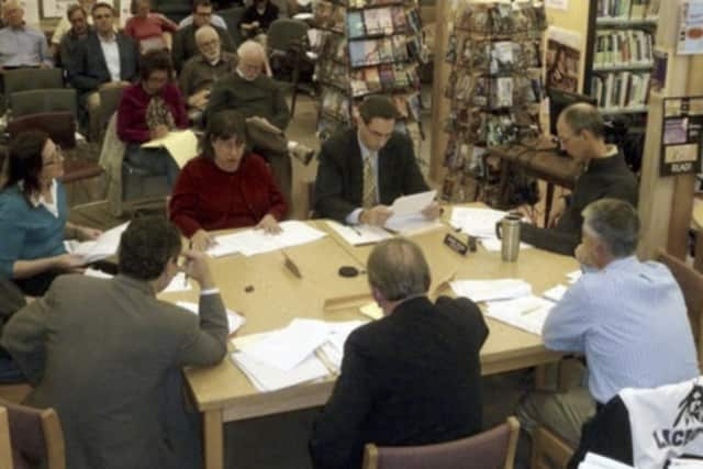 Lewisboro Library Director Cindy Rubino (in red), presents the proposed 2013 library budget to the Town Board.