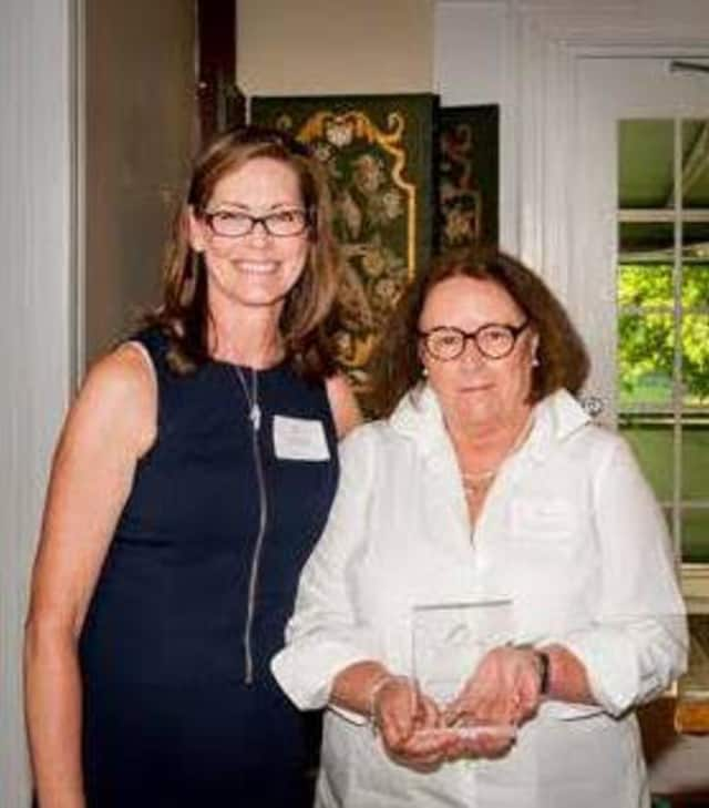 Patty Donovan-Duff, right, director of the Bereavement Center of Westchester, left, received the Community Fund Award for her work at the center. At left is Melinda Burge, director of The Community Fund.