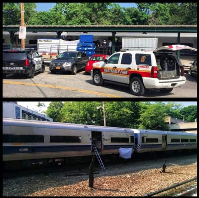 Police responding to the scene in Hartsdale after a man was struck by a train.