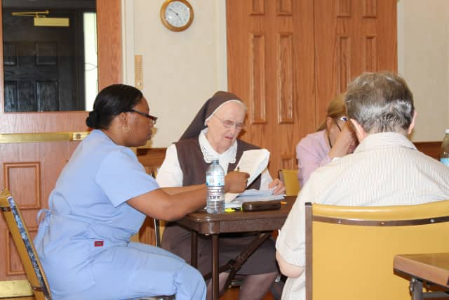 Audrey Henry and Sister Jean Beyette during the dementia care training program.