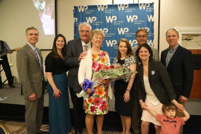 """Guest of honor Karen """"Toby"""" Haghenbeck and her fiancé, Bill Nunnink pose with other past survivor honorees and Hospital leaders"""