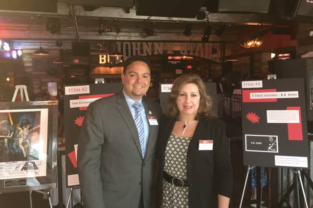 Carlos Reinoso and Kim Killoy of the Human Services Council at Johnny Utah's for the start of the seventh annual SoNo Stroll in 2015. Wednesday the eight annual version of the event will be held.